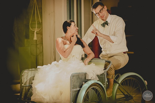 Bride and groom sitting in cart for post wedding shoot picture