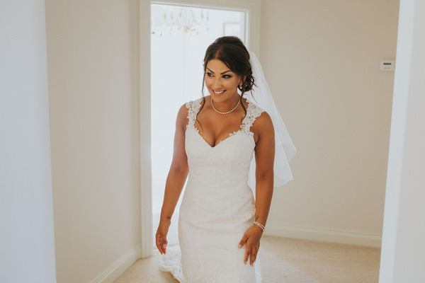 Bride wearing Stella York wedding dress
