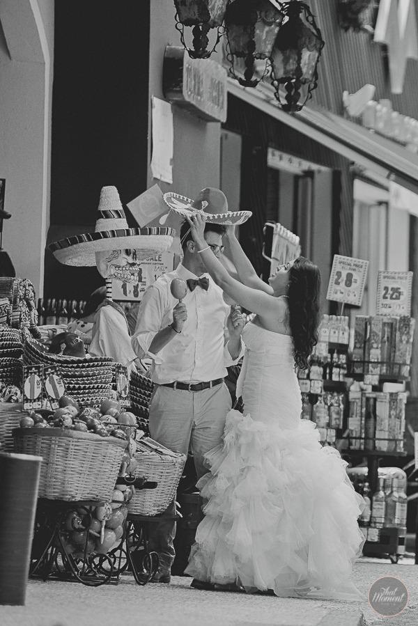 Bride putting sombrero on groom's head