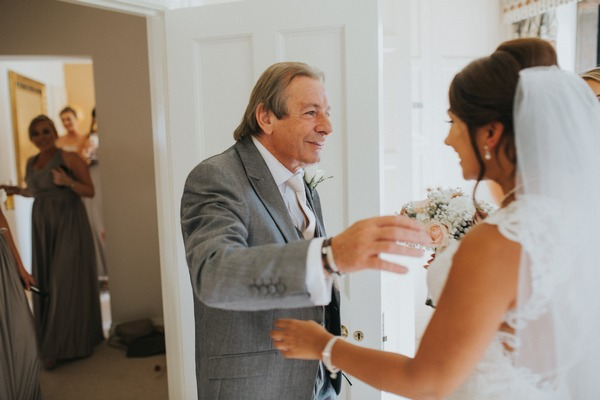 Father about to hug bride