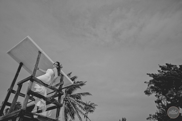 Bride leaning back from wooden view point