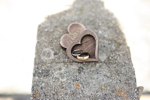 Wedding rings in wooden heart