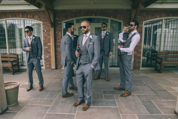 Groomsmen waiting at wedding venue