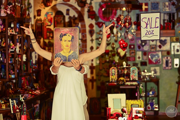 Groom holding painting over bride's face