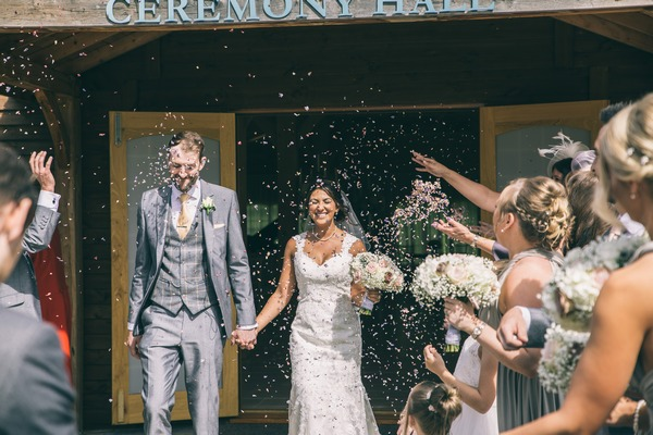 Bride and groom leave The Stables at Colshaw Hall to shower of confetti