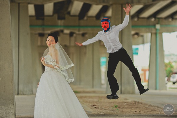 Groom with devil balaclava jumping out on bride