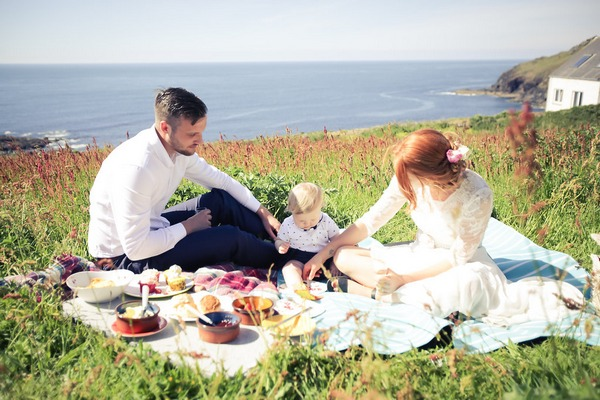 Bride and groom having picnic after BoHo Cornwall elopement