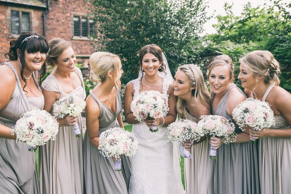 Bride with bridesmaids in silver and grey dresses
