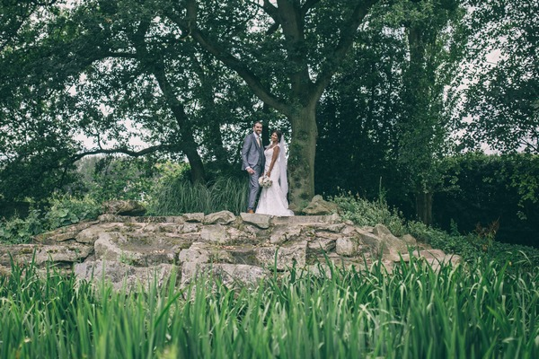 Bride and groom in grounds of Colshaw Hall