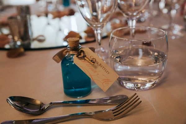 Blue bottle wedding place setting