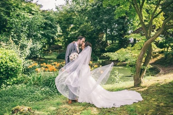 Bride and groom kissing after Colshaw Hall wedding