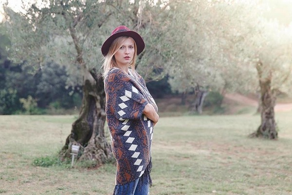 Bride to be wearing boho style poncho