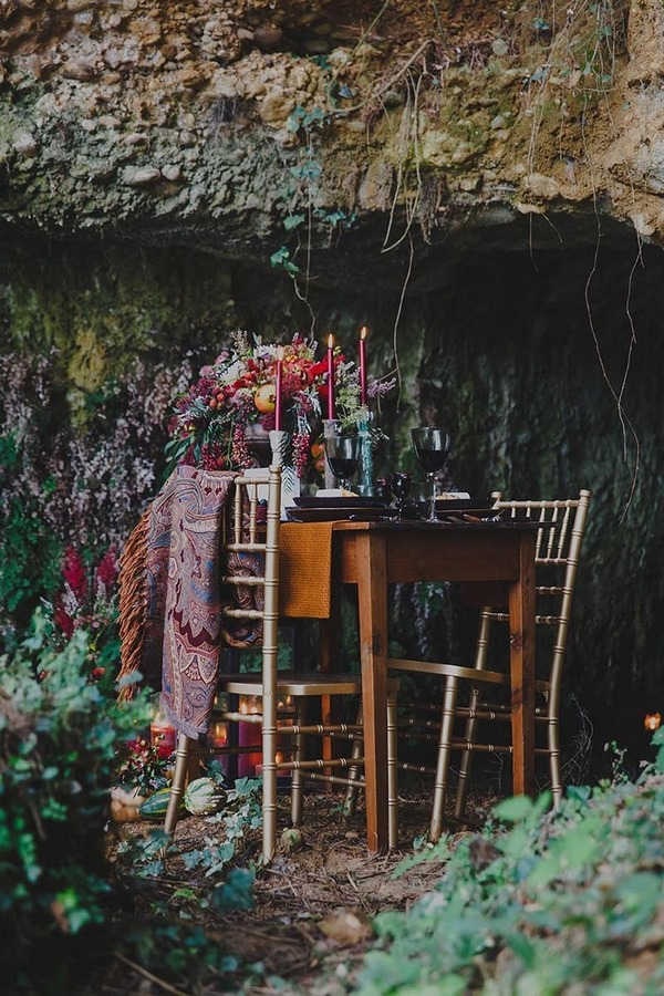 Rustic dinner table at entrance to cave