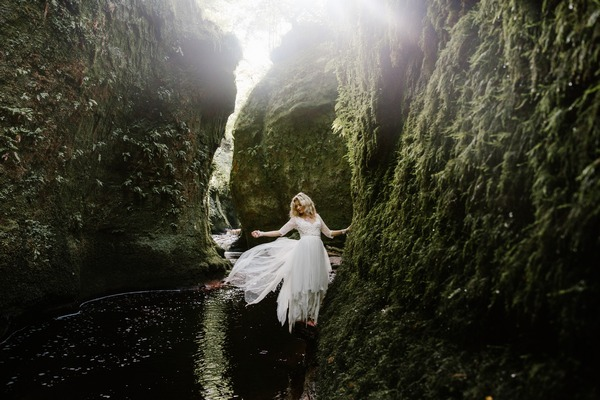 Bride standing on rocks of The Devil's Pulpit - Picture by Christine McNally Photography