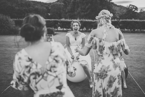 Bride bouncing on space hopper - Picture by Neil Jackson Photographic