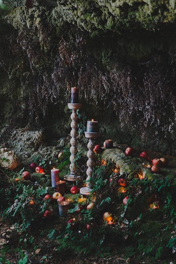 Candles and apples in woods