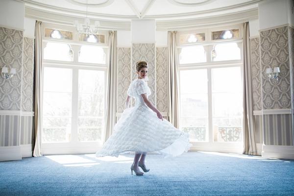 Bride twirling in The Duke of Cornwall Hotel
