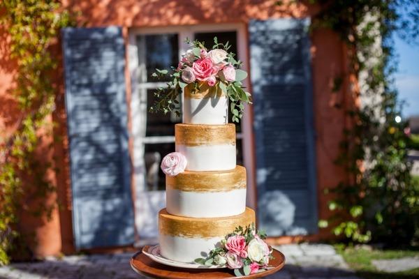 Gold and white stripe wedding cake