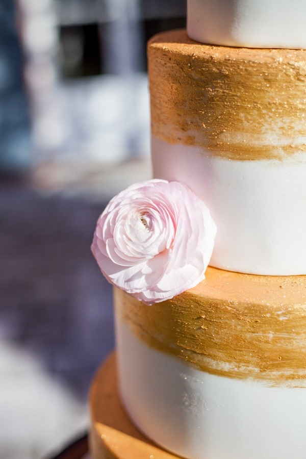Flower on side of wedding cake
