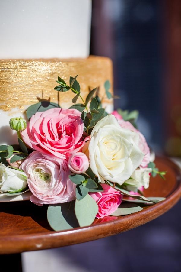 Flowers at bottom of wedding cake