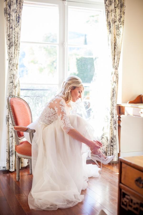 Bride putting on shoe