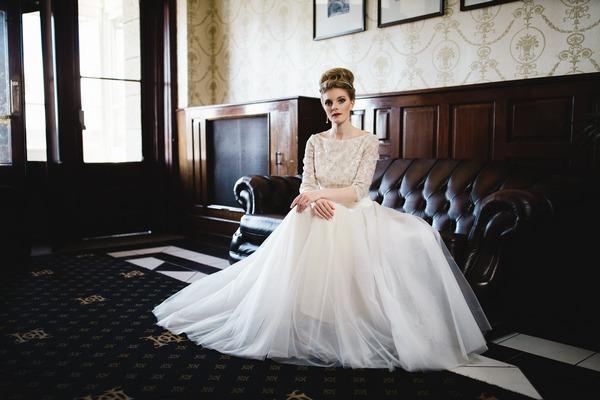 Bride sitting on sofa in The Duke of Cornwall Hotel