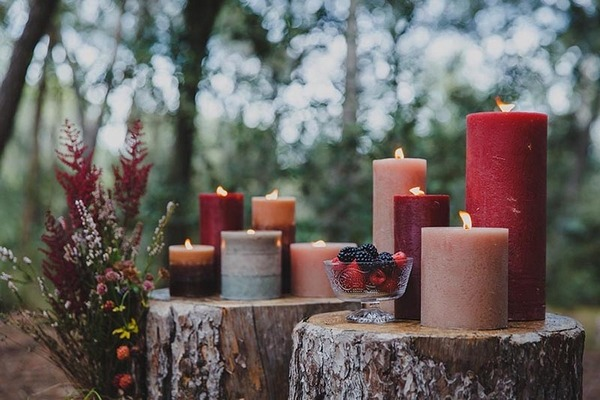 Candles on tree stumps