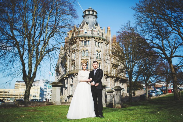 Bride and groom in front of The Duke of Cornwall Hotel