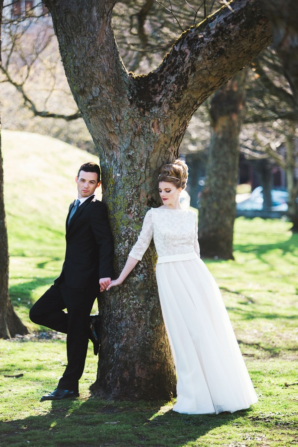 Bride and groom by tree