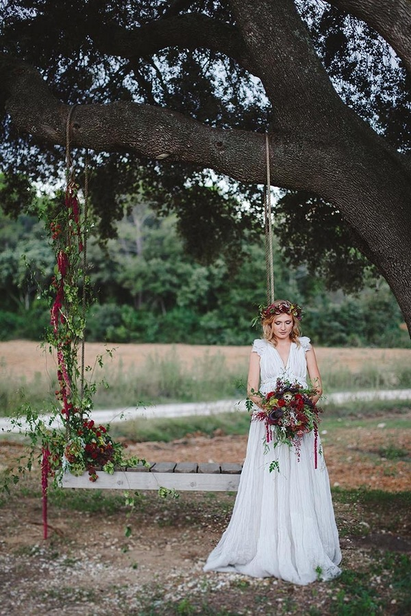 Boho bride by tree swing