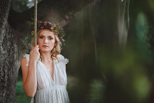 Bride holding rope of swing