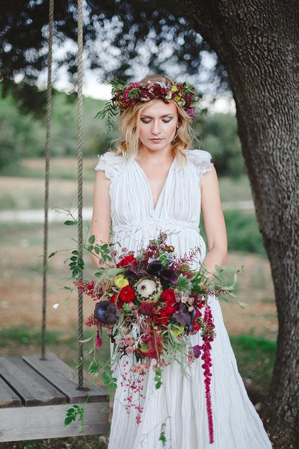 Bride holding autumn wedding bouquet