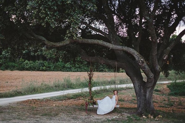 Bride laying on swing