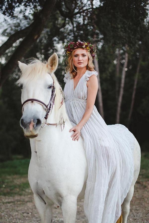 Boho bride sitting on horse