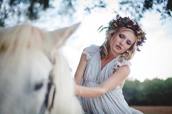 Boho bride riding horse