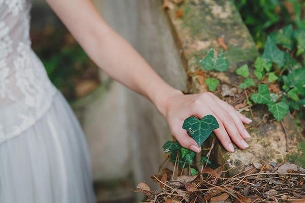 Bride's hand touching leaf