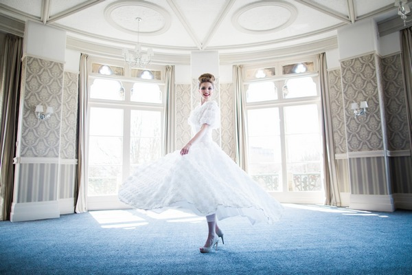 Bride twirling in The Hayward Room in The Duke of Cornwall Hotel