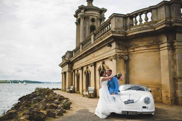 Couple sitting on wedding car