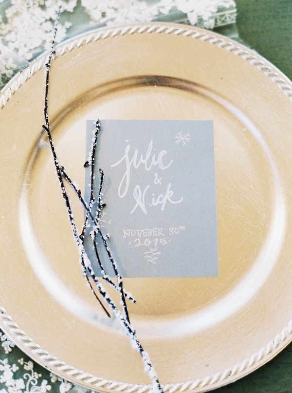 Blue winter wedding invitation on plate