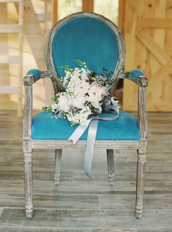 Wedding bouquet on blue chair