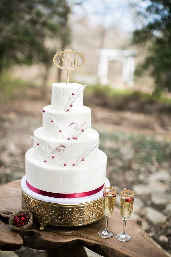 White wedding cake with birds and berry detail