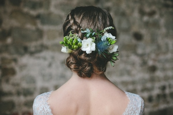 Bride's updo with hair flowers