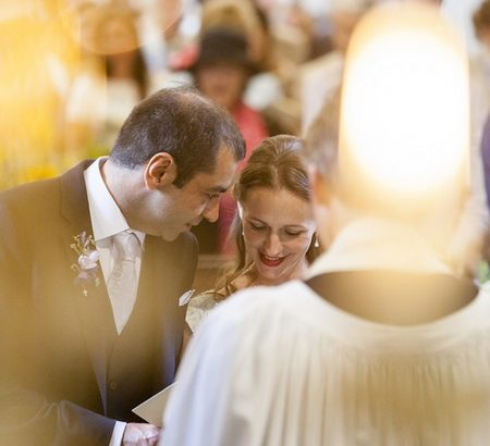 Groom talking to bride at altar - Picture by Kismet Photography