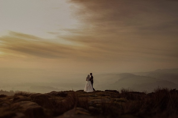Bride and groom on top of hill in Peak District - Picture by Jess Petrie Photography