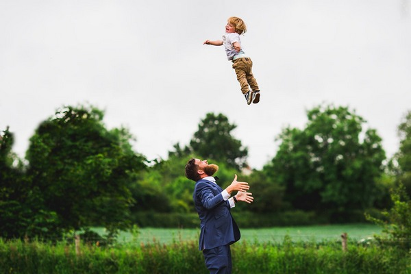 Man throwing child high in the air - Picture by Aaron Storry Photography