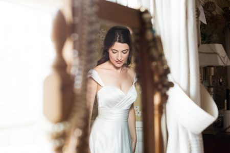 Reflection of bride in mirror - Picture by Fiona Kelly Wedding Photography