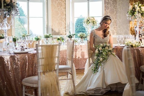 Bride sitting in Wyck Hill House holding bouquet
