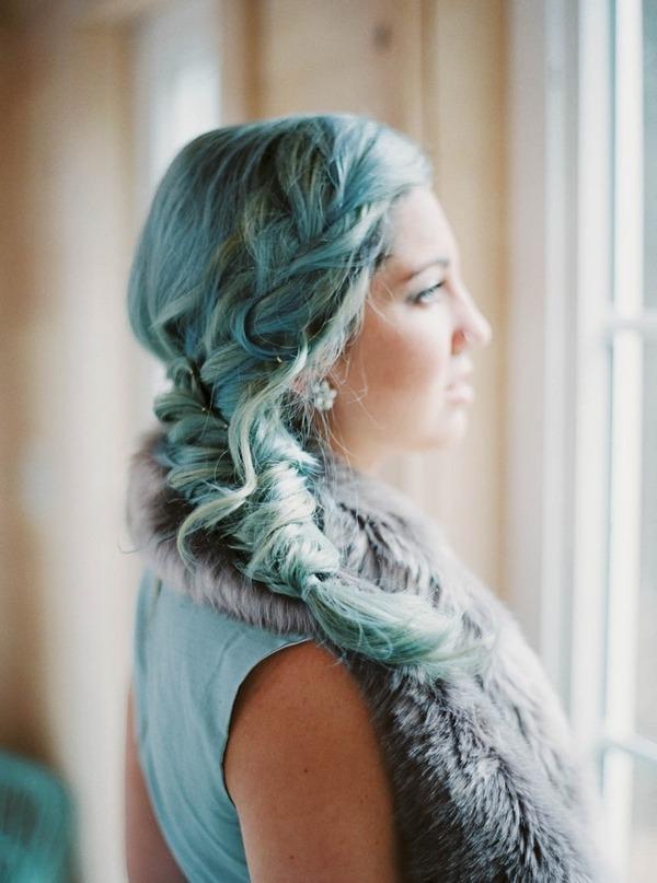 Bride's loose plait hairstyle