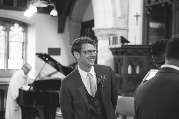Groom waiting in church for bride