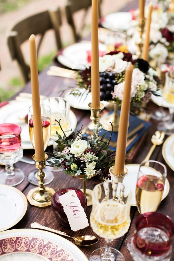 Gold candles on wedding table